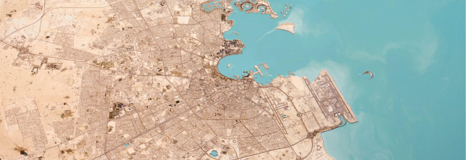 Aerial view of Doha, showing roadways and port